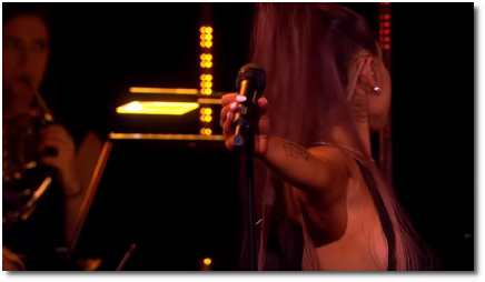 Ariana turns away from the audience while singing God is a Woman at the BBC with an all-woman orchestra (29 Oct 2018).