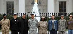 Gay military protestors chain themselves to gate at White house
