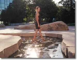 Lani walks on water at Noguchi Garden Park in downtown Costa Mesa, California