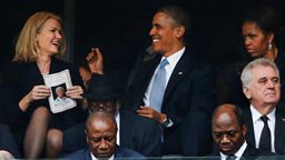 Obama with Denmark's Helle Thorning-Schmidt at Mandela's funeral on December 10, 2013, as Michele looks on, oviously not happy