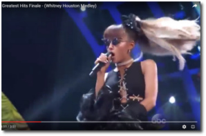 Ariana's signature trademark ponytail trying to keep up while she sings a Whitney Houston medley on ABC Greatest Hits Finale August 4, 2016